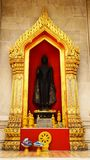 Gold Arch and black Buddha Statue Wat Benchamabophit The Marble Temple Tourism royalty free stock image