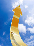 Gold arrow - aspire to sky Stock Photography