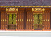 Gold art window Thai temple. Lanna gold asian art window Thai temple Stock Image