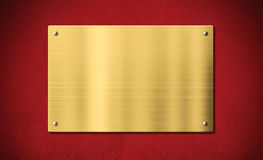 Gold award plaque or plate on red background. Gold award plaque or plate on red wall stock photo
