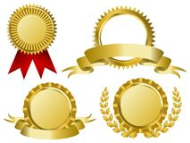 Gold award ribbons. On white Royalty Free Stock Photography