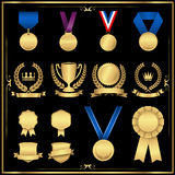 Gold Award Set. Shiny gold award set with emblems, medals, ribbons, and trophy.  Colors are global swatches, so they can be modified easily.  File is layered Royalty Free Stock Photo