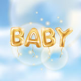 Gold baby balloons Royalty Free Stock Image