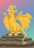 Gold baby dragon on the rock Stock Photo
