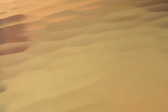 Gold back ground. Golden Surface reflecting the light, Gold Royalty Free Stock Image