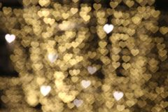Gold background bokeh lights heart soft, heart Background colorful. The gold background bokeh lights heart soft, heart Background colorful Royalty Free Stock Images
