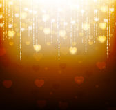 Gold background with bright hearts and sparkles Royalty Free Stock Image