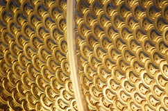 Gold background. Continuous gold curve surface background Royalty Free Stock Photography