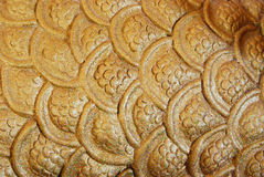 Gold background. Continuous gold curve surface background Stock Photo