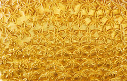 Gold background. Continuous gold flower surface background Stock Photos