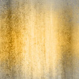 Gold background with gray frame. Abstract gold background gray border warm colors with sponge vintage grunge background texture, distressed rough smeary paint on stock photography