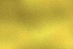 Gold background. Metal foil decorative texture Royalty Free Stock Photos