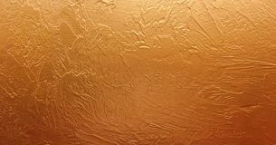 Gold background paper, texture is old vintage distressed solid gold color with rough peeling grunge paint on edges. Gold background paper, texture is old Royalty Free Stock Photo
