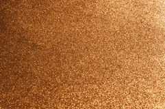 Gold Background. Gold sparkling, glittering the background Royalty Free Stock Photo