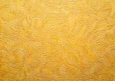 Gold background texture. Wallpaper on the wall. Royalty Free Stock Photography