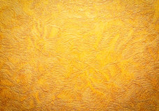Gold background texture. Wallpaper on the wall. Royalty Free Stock Images