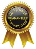 Gold badge customer satisfaction guaranteed in black background royalty free stock photography