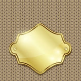 Gold badge over seamless knitted texture Royalty Free Stock Image