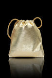 Gold bag in black background Stock Images