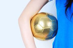 Gold Ball. In the hand of player Stock Photos