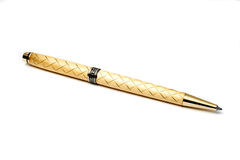 Gold ball-point pen Royalty Free Stock Image