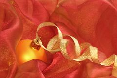 Gold ball and ribbon Royalty Free Stock Images
