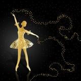 Gold ballerina on dark background. Royalty Free Stock Image