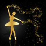 Gold ballerina on dark background. Stock Photography