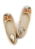Gold ballet shoes for women. Stock Photos