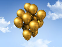 Gold balloons on a blue sky Royalty Free Stock Photography