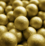 Gold Balls. A background of golden balls with the focus on the one in the middle Stock Photos