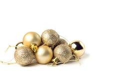 Gold balls. On white background Stock Photos