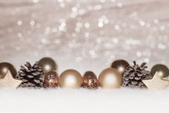 Gold  balls on golden lights Christmas background Stock Photography