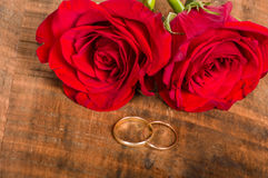 Gold bands on wooden table Stock Photos