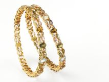 Gold bangles with diamonds Stock Image
