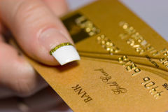 Gold bank card in arm Royalty Free Stock Images