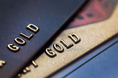 Gold bank card Stock Images