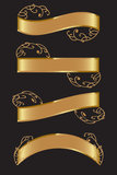Gold banners. Set of gold banners with golden swirls attached Royalty Free Stock Photo