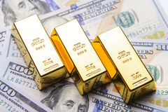 Gold bar with american hundred dollar bills Stock Photography