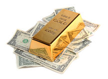 Gold bar with bank notes royalty free stock photography