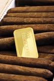Gold bar in cigar box Stock Photography