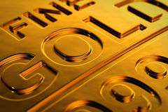 Gold bar close-up. Close-up view of a gold bar with shallow depth of field Stock Photos