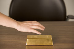 Gold Bar On Desk Royalty Free Stock Images