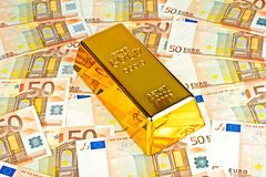 Gold bar and euro money. Currency Stock Photos