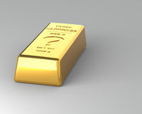 Gold bar on Gray Background Royalty Free Stock Images