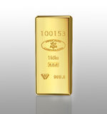 Gold bar. On gray gradient background Royalty Free Stock Photography