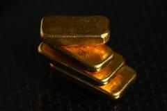 Gold bar on gross background scene. stock image