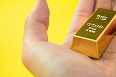 gold bar in hand Stock Images