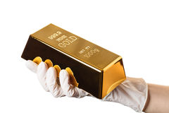 Gold bar in hand. On white background isolated Royalty Free Stock Photos