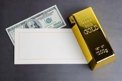 Gold bar ingot bullion dollar bill and greeting card stock photo